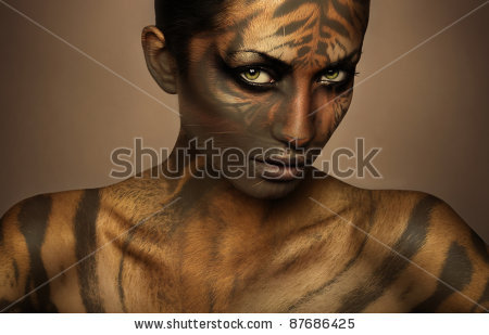 stock-photo-attractive-sexy-tiger-woman-87686425.jpg