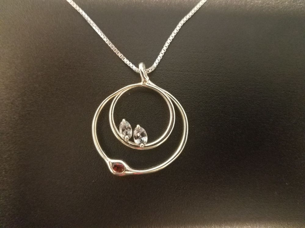 Garnet (my birthstone) on the outer circle cradling the two sapphires (the twins) - all found in Montana