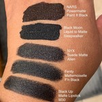 Swatches of 5 matte black lipsticks. One is clearly deeper in the void than the others. :D
