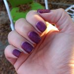 Bright daylight, shaded. The finish is relatively matte, and it's hard to tell there's sparkle in there