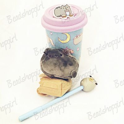 PUSHEEN! The cutest ceramic mug with travel lid, a blind box Gund stuffy (Pusheen fits in the little bag), an eraser, and a pen!