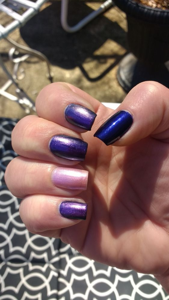 I had a hard time capturing the color on the nails with both colors, but it's a lovely shimmery grape purple