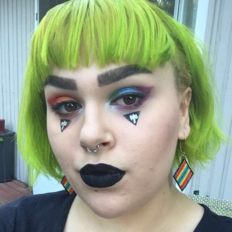 eyeshadow inspired by Gilbert Baker's pride flag with lesbian flag motifs(black triangle with labrys). Im proud to be a twospirit lesbian!