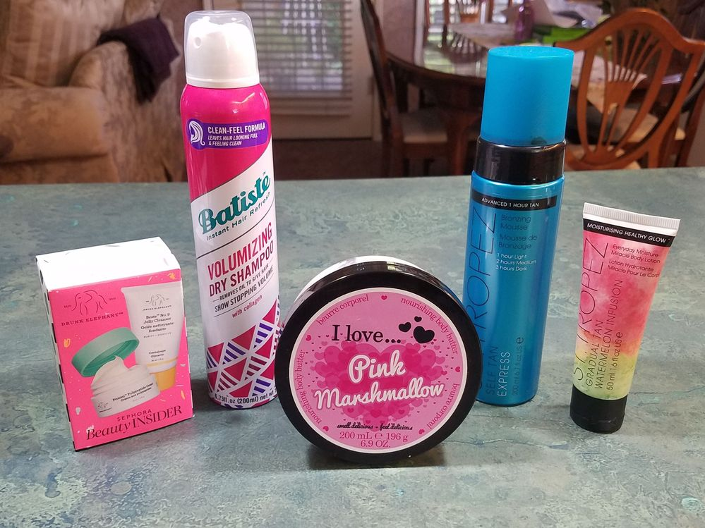The DE set was my Sephora birthday gift, the Batiste volumizing dry shampoo is something I use mostly as a hair perfume because it smells amazing, the St. Tropez Express Mousse is my absolute favorite self-tanner (without it I'm pathetically pale--so I actually bought a few), and the Pink Marshmallow body butter is such a fun scent.
