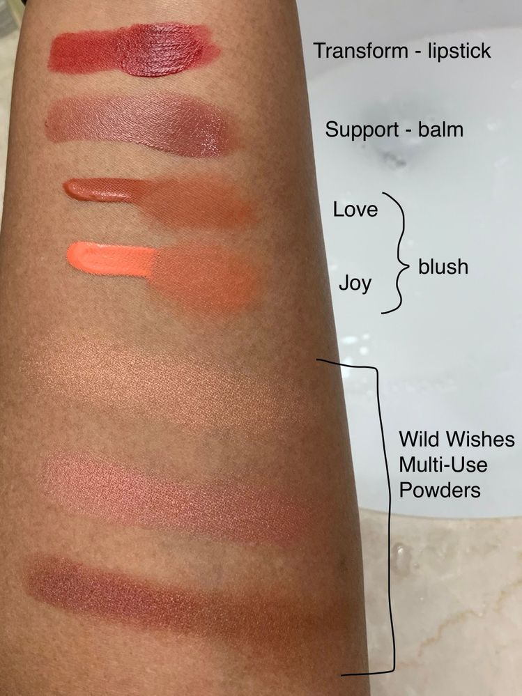 Swatches of Rare Beauty and Sephora Wild Wishes powders.