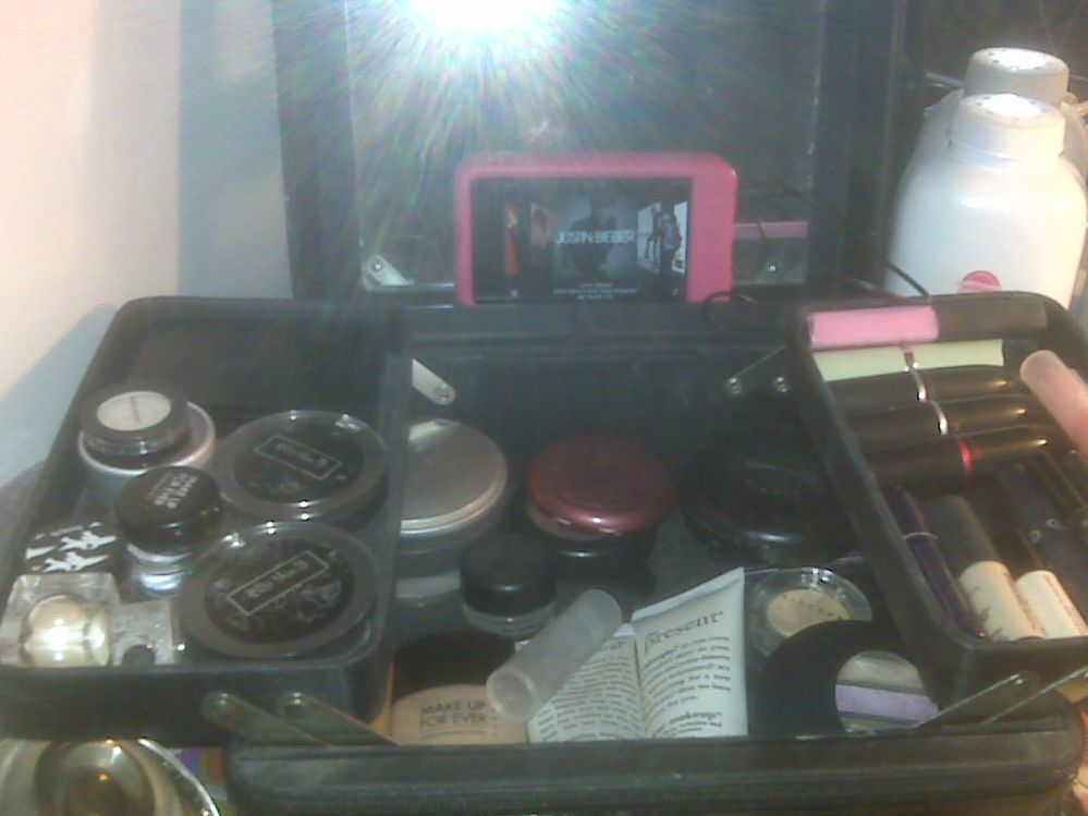 My Stila music player case. It carries what I need when traveling.